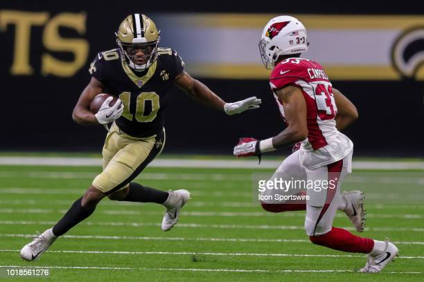 New Orleans Saints wide receiver Tre'Quan Smith is tackled by Arizona Cardinals defensive back Chris Campbell in an NFL preseason football game...