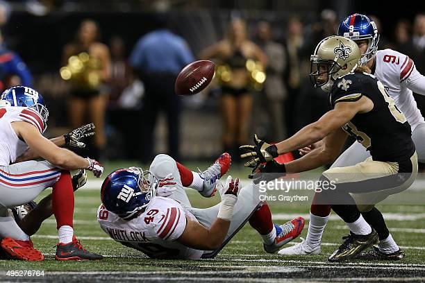 New Orleans Saints wide receiver Willie Snead picks up a fumble against the New York Giants at MercedesBenz Superdome on November 1 2015 in New...