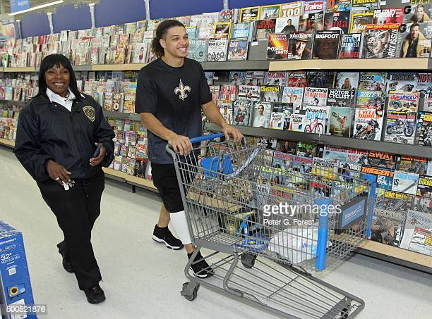 New Orleans Saints wide receiver Willie Snead walks down the isle at Walmart Supercenter on December 8 2015 in Harahan Louisiana