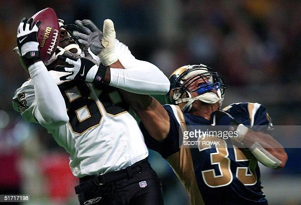 New Orleans Saints' Willie Jackson catches a 49yard touchdown pass from Aaron Brooks as St Louis Rams' Aeneas Williams attempts to defend in the...