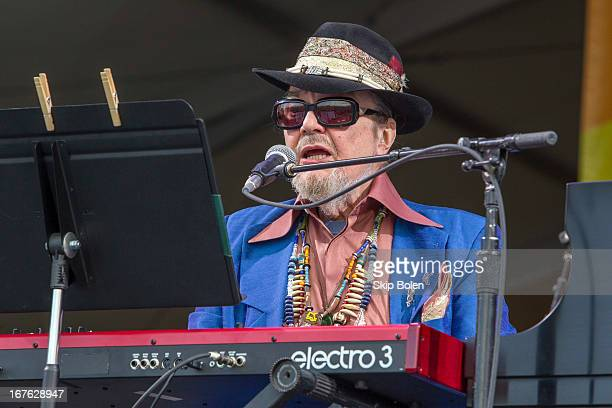New Orleans singersongwriter and musician Dr John performs during the 2013 New Orleans Jazz Heritage Music Festival at Fair Grounds Race Course on...