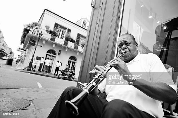 new orleans street musician playing clarinet - blues music stock pictures, royalty-free photos & images