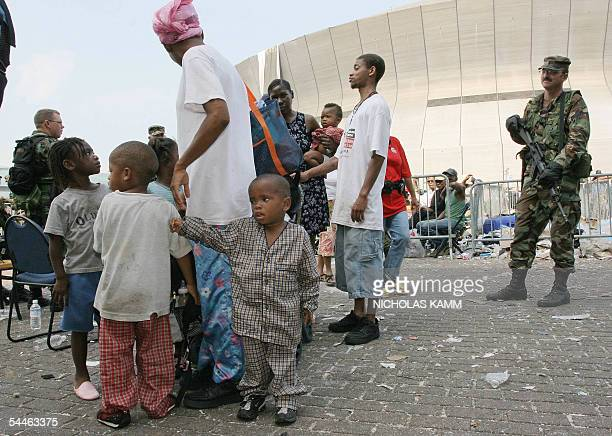 A family waits to be evacuated from the Superdome in New Orleans 03 September 2005 six days after hurricane Katrina hit the city Some 3000 people are...