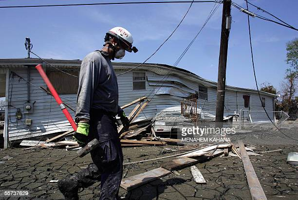 A Member of the Miami Task Force does a housetohouse search in a devastated neighborhood of eastern New Orleans 21 Septembe 2005 Authorities have...