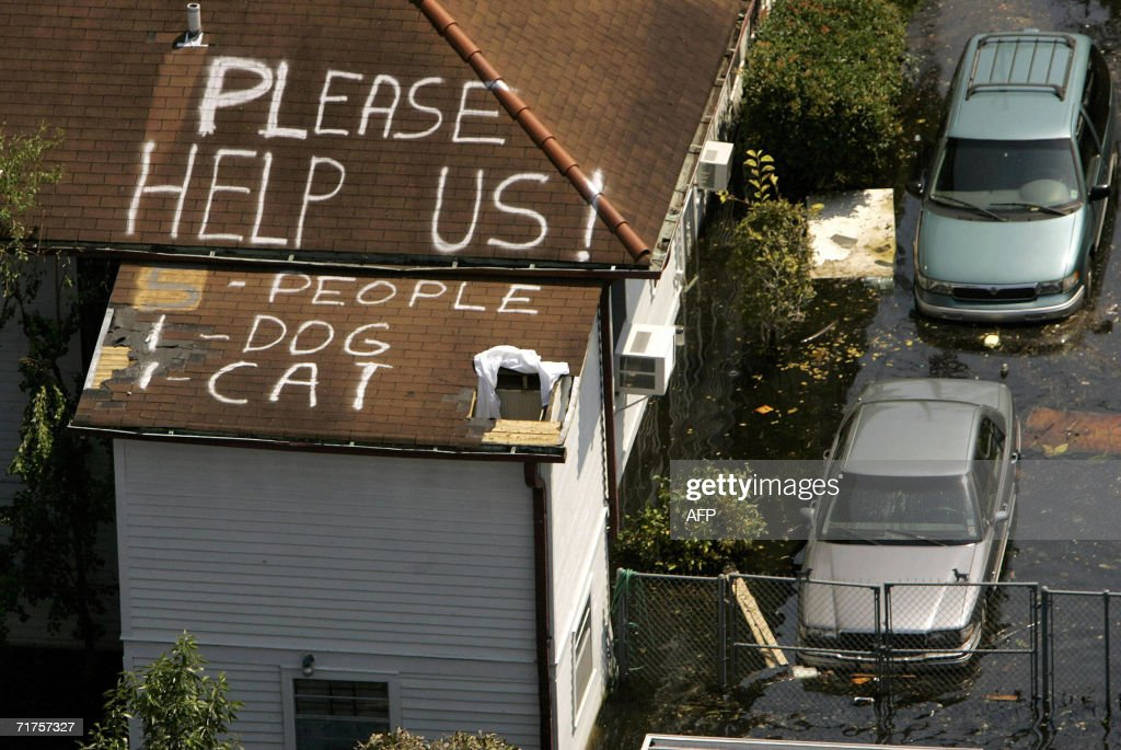 A plea for help appears on the roof of a home flooded in the aftermath of Hurricane Katrina in New Orleans, Louisiana, 04 September 2005. New Orleans began counting its dead 04 September as US troops turned to the gruesome task of harvesting bloated corpses from the hurricane-torn city's flooded streets and homes. AFP PHOTO/POOL/Robert GALBRAITH