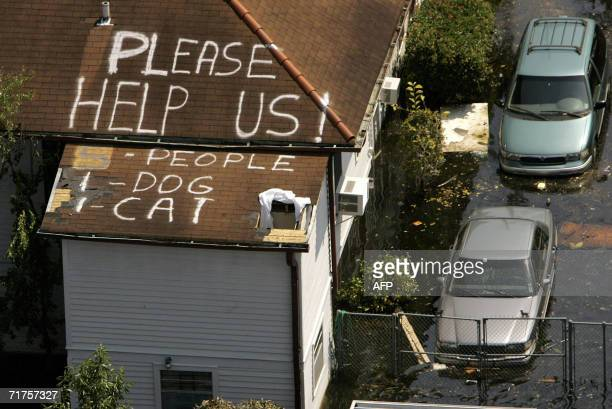 New Orleans, UNITED STATES: A plea for help appears on the roof of a home flooded in the aftermath of Hurricane Katrina in New Orleans, Louisiana, 04...