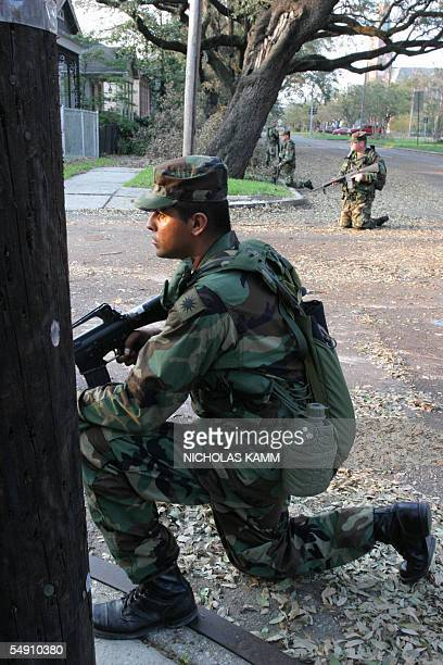 A US National Guard take position during a patrol in search of damage in the Garden district of New Orleans 05 September 2005 More than 2800 soldiers...