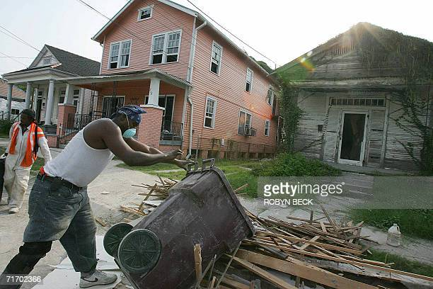 Frederick Smith removes debris from the home of his brotherinlaw Don Woods as they gut Woods' home n the Lower Ninth Ward of New Orleans Louisiana 11...