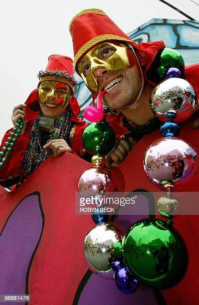 Jeremy Herschaft and his wife Niki throw beads from a float during the Pontchartrain parade opening at the Mardi Gras celebrations in New Orleans 18...