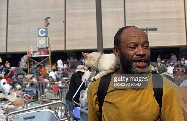 Joseph Barnes and his cat Patches wait to be evacuated from the Superdome in New Orleans 03 September 2005 six days after Hurricane Katrina hit the...