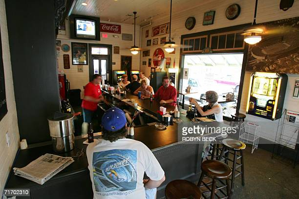 Locals catch up on the latests news at the Parkway Bakery and Tavern in New Orleans for live music and company 08 July 2006 In the areas flooded by...