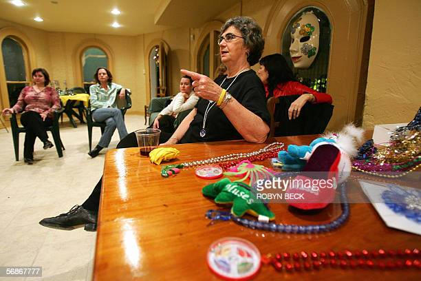 Marcelle Saussy the oldest member of the allwomen Muses Mardi Gras krewe or team makes a point during the team's float party and meeting at the home...