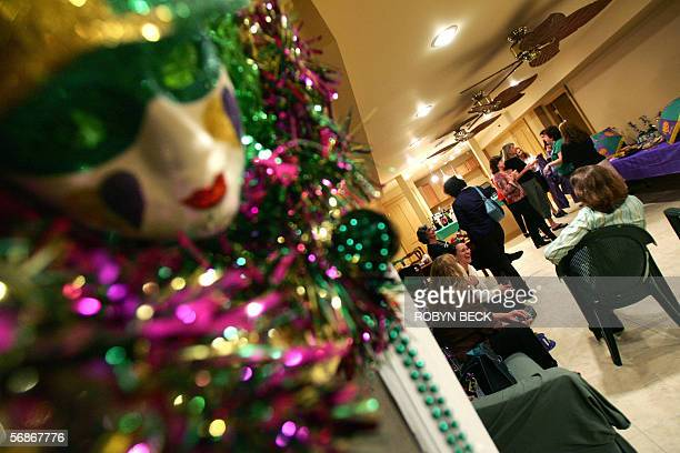 Members of the allwomen Muses Mardi Gras krewe or team discuss their team's plan at a float party and meeting at the home of member Pam Lyles in New...