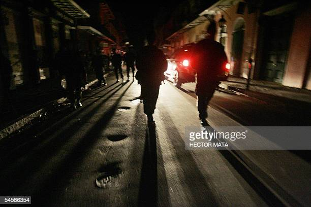 New Orleans, UNITED STATES: Members of the US Army 82nd Airborne Division based out of Fort Bragg, South Carolina patrol the streets of New Orleans'...
