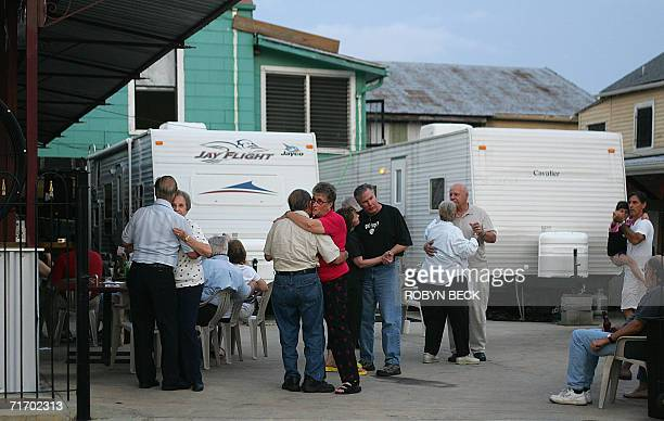 Patrons dance to live music in a courtyard beside emergency shelter trailers at the Parkway Bakery and Tavern in New Orleans 08 July 2006 With the...