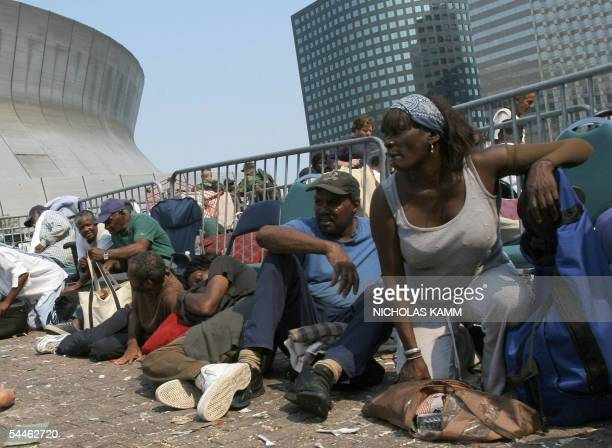 People waiting to be evacuated from the Superdome take cover after the National Guard reported shots being fired outide the arena 03 September six...