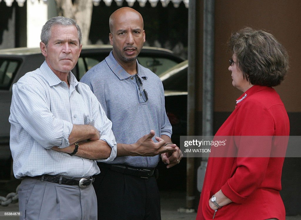 US President George W. Bush (L) looks on as Mayor Ray Nagin (C) and Lousiana Governor Blanco (R) talk in an area of New Orleans, Louisiana, where the flood waters recently receeded 12 September 2005. It will be months before it can call itself 'The Big Easy' again, but New Orleans is slowly edging back from the brink as it enters its third week since Hurricane Katrina unleashed her fury. But entire neighborhoods are still stewing in a quagmire of mud and foul floodwater that in some cases almost reach up to rooftops. AFP PHOTO/Jim WATSON