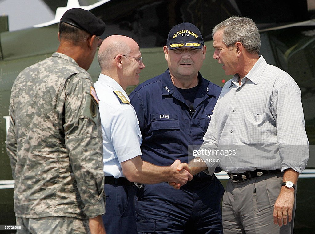 us president george w bush r shakes hands with us coast guard rear