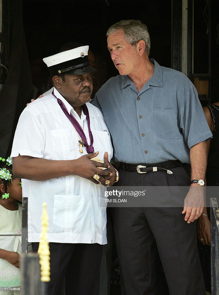 US President George W. Bush (R) speaks with US rock & roll legend Fats Domino (L) 29 August 2006 in the Lower Ninth Ward of New Orleans, Louisiana, on the first anniversary of Hurricane Katrina. Bush spoke about replacing the Domino's Presidential Medal for the Arts, which was lost in flooding at the singer's Lower Ninth Ward residence during the disater.
