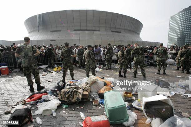 US soldiers guard people waiting to leave the Superdome in New Orleans 01 September 2005 Rampant lawlessness prompted Louisiana state leaders to ask...
