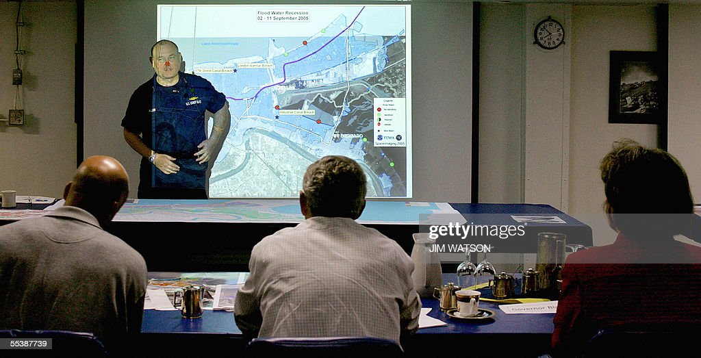 Vice Admiral Thad Allen (facing camera) speaks as he gives US President George W. Bush (C), New Orleans Mayor Ray Nagin (L) and Louisiana Governor Kathleen Blanco a briefing on hurricane Katrina recovery onboard the USS Iwo Jima in New Orleans, LA, 12 September 2005. Embattled Federal Emergency Management Agency (FEMA) chief Mike Brown's resignation earlier in the day seemed to catch Bush and the White House flat-footed. Asked about news reports that Brown had quit, Bush told reporters on a tour of the stormed-ravaged US Gulf Coast: 'I can't comment on something that you may know more about than I do.' AFP PHOTO/Jim WATSON