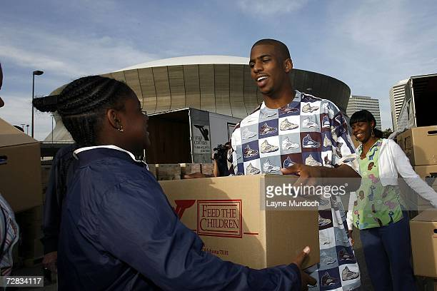 New Orleans/Oklahoma City Hornets guard Chris Paul hands out food to 800 New Orleans families as part of the NBA Cares campaign on December 15 2006...