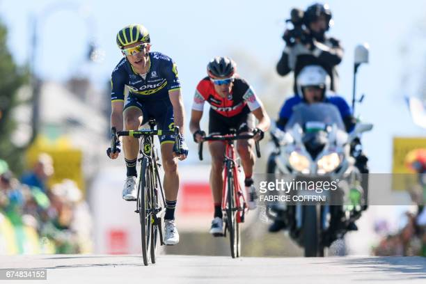 New overall leader Britain's Simon Yates of team OricaScott sprints ahead of Australia's Richie Porte of team BMC to win the fourth stage of the Tour...