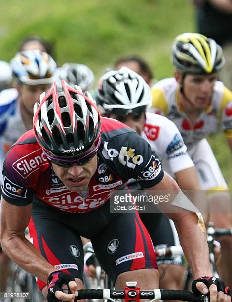 New overall leader's yellow jersey Australian team leader Cadel Evans rides Super-Besse and Bagneres-de-Bigorre winner, Italian Riccardo Ricco , on...