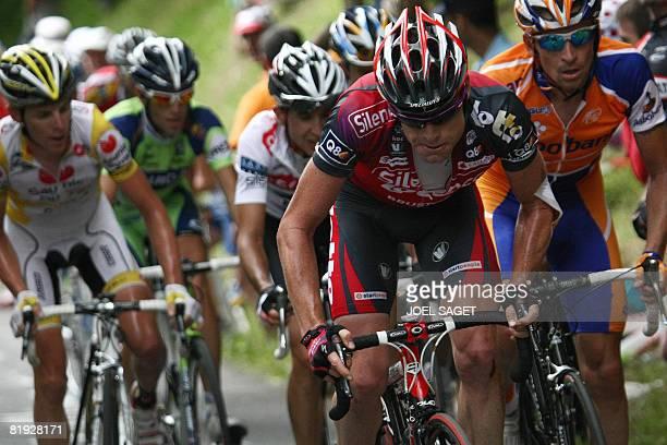 New overall leader's yellow jersey Australian team leader Cadel Evans rides Super-Besse and Bagneres-de-Bigorre winner, Italian Riccardo Ricco and...