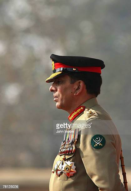 New Pakistani military chief Gen Ashfaq Kayani watches as troops pass by during a change of command ceremony November 28 2007 in Rawalpindi Pakistan...
