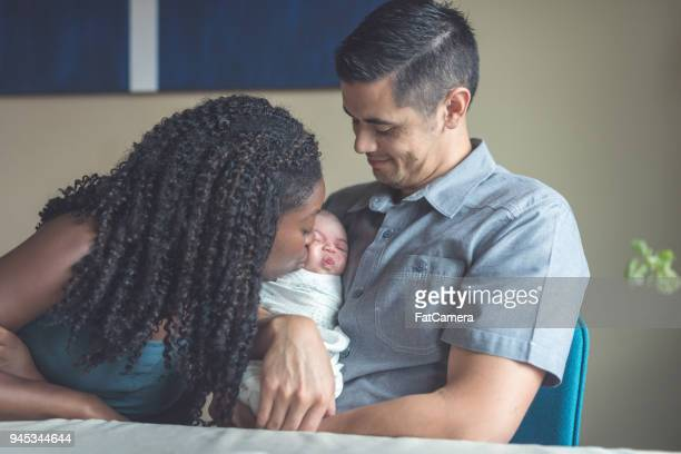 new parents snuggle with their newborn daughter - waterloo iowa stock pictures, royalty-free photos & images
