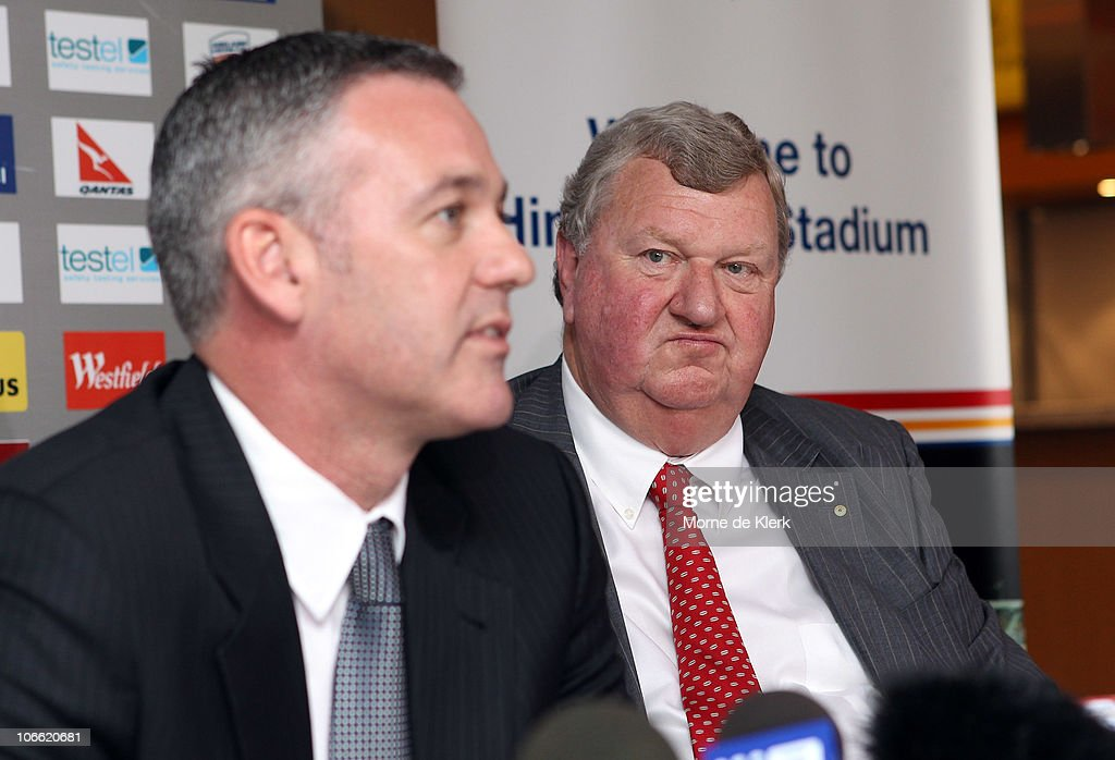 New part owner, Rob Gerard, listens as Football Federation Australia CEO Ben Buckley speaks during a media conference announcing the new owners of the Adelaide United Football Club at Hindmarsh Stadium on November 8, 2010 in Adelaide, Australia.