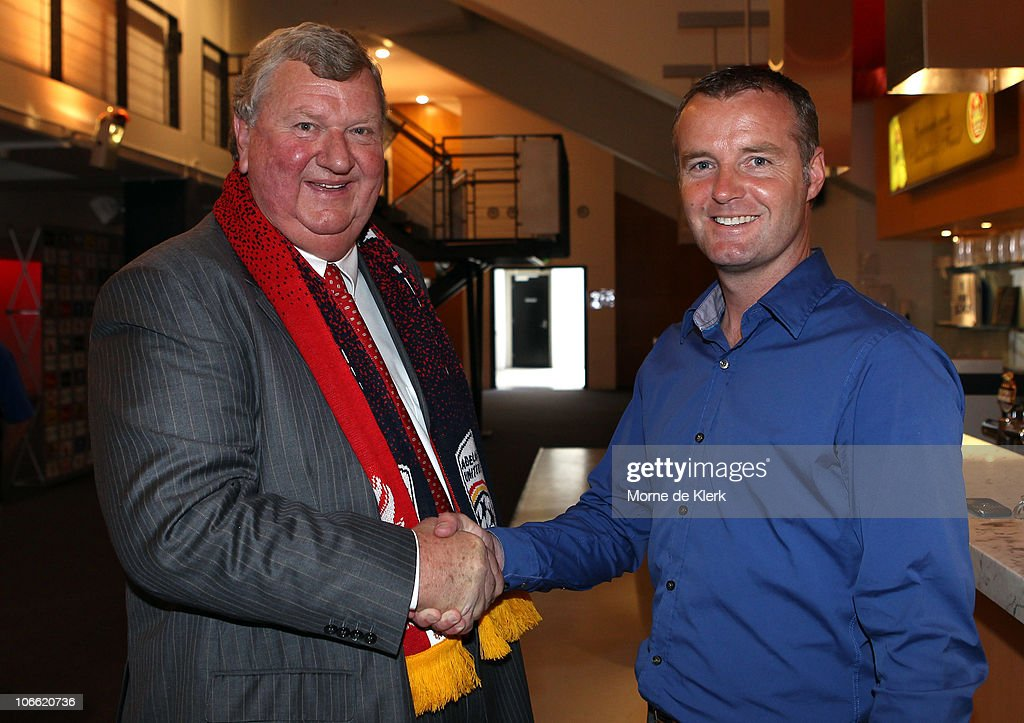 New part owner, Rob Gerard, shakes hands with coach Rini Coolen after a media conference announcing the new owners of the Adelaide United Football Club at Hindmarsh Stadium on November 8, 2010 in Adelaide, Australia.