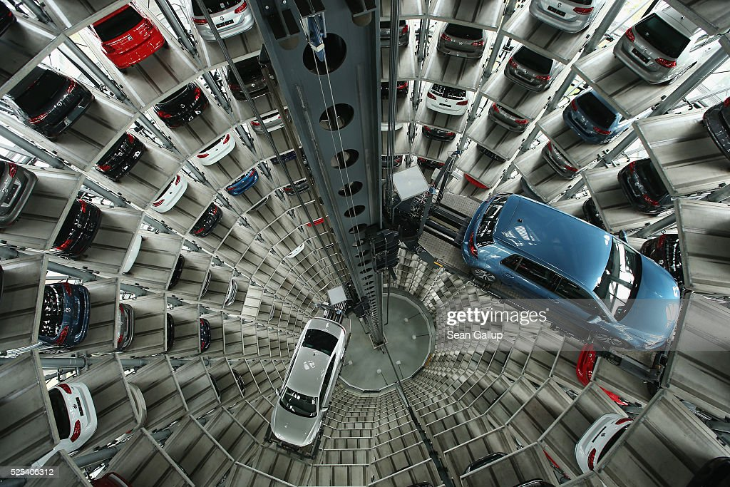 New passenger cars of German automaker Volkswagen AG await their new owners in one of the twin car towers at the Volkswagen factory on day of the company's annual press conference on April 28, 2016 in Wolfsburg, Germany. Volkswagen is facing high costs and stiff penalties, including the possible buyback of up to 500,000 cars it sold in the USA, as a reult of VW's diesel emissions scandal. The twin car towers in the Autostadt park adjacent to the factory are 48 meters tall and have a capacity of 800 cars.