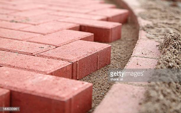 new path of red block paving - paving stone stock pictures, royalty-free photos & images
