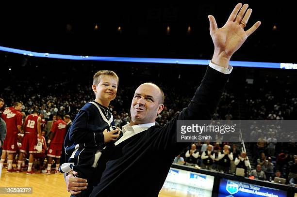 New Penn State head football coach Bill O'Brien is announced to the crowd, with his 6-year-old son Michael, during a timeout at the Penn State...
