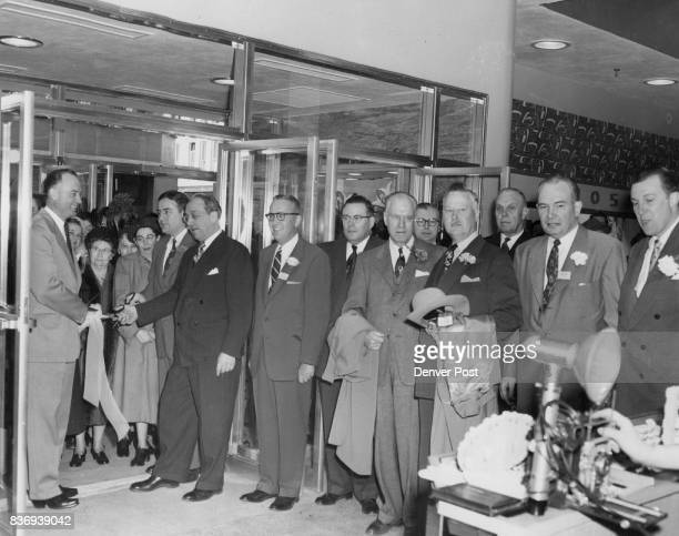 New Penney Store Opens Palmer Hoyt editor and publisher of the Denver Post cuts the ribbon held by Governor Thornton and Mayor Newton Thursday as JC...