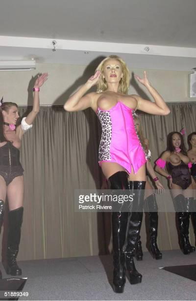SEPTEMBER 2001 New Penthouse Pet of the Year Natasha Brock performs at the L'Aqua restaurant at Darling Harbour Sydney Australia