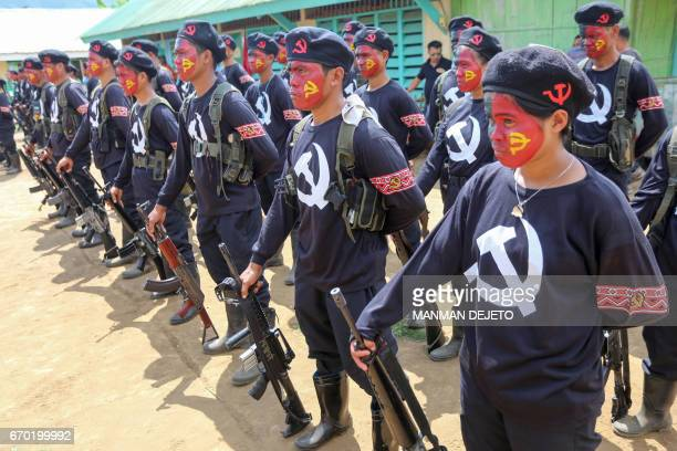 New Peoples Army guerillas the armed wing of the Maoist rebels stand in formation during the turnover ceremony of captured government soldiers to...