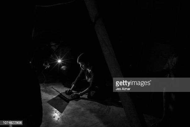 New Peoples Army guerillas work on their laptops inside a villagers house on December 12 2018 in a remote village in the Bicol region Philippines...