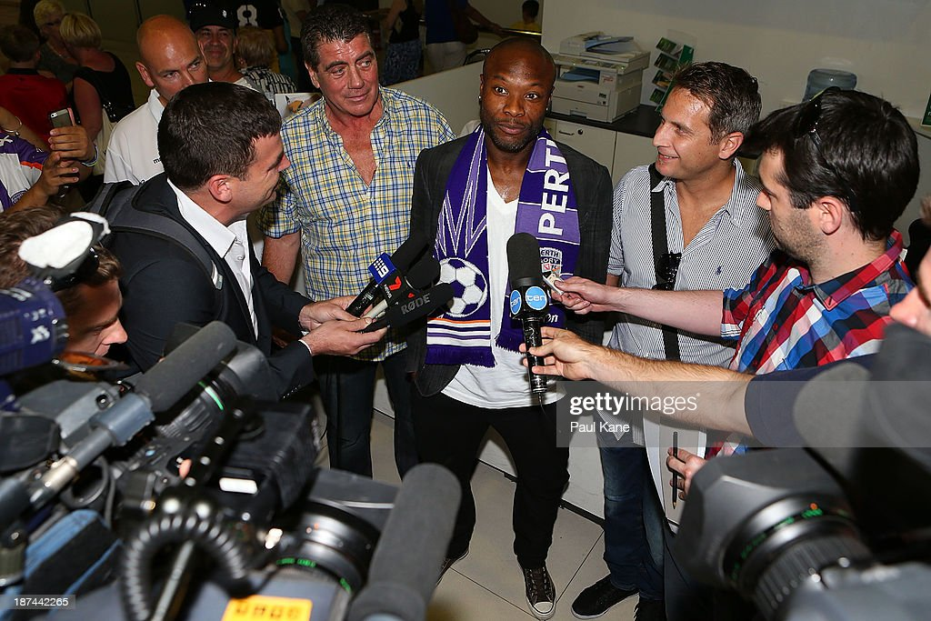 New Perth Glory A-League recruit William Gallas talks with the media after arriving at Perth International Airport on November 9, 2013 in Perth, Australia.