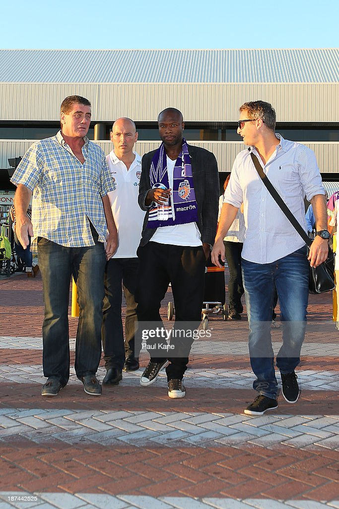 New Perth Glory A-League recruit William Gallas walks to his waiting car after arriving at Perth International Airport on November 9, 2013 in Perth, Australia.