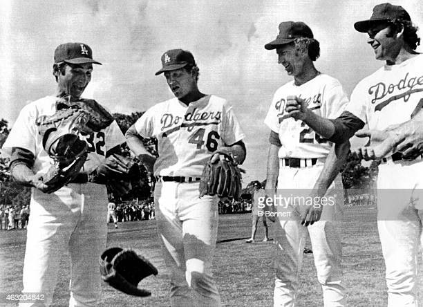 New pitching coach Sandy Koufax of the Los Angeles Dodgers asked for a glove and Burt Hooton Don Sutton and Andy Messersmith offered their gloves...