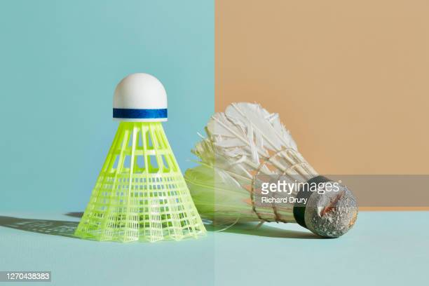 new plastic and old feather shuttlecocks - old fashioned stock pictures, royalty-free photos & images