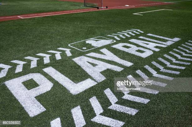 A new PlayBall logo a joint initiative between MLB and USA Baseball promoting the sport is painted on the turf shown before the game between the New...