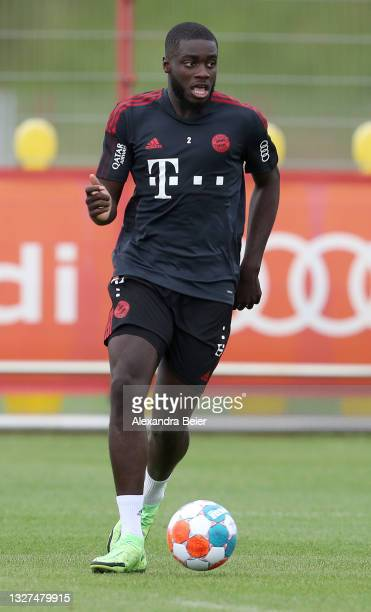 New player Dayot Upamecano of FC Bayern Muenchen kicks the ball during his first training session of the upcoming season 2021/2022 on July 07, 2021...