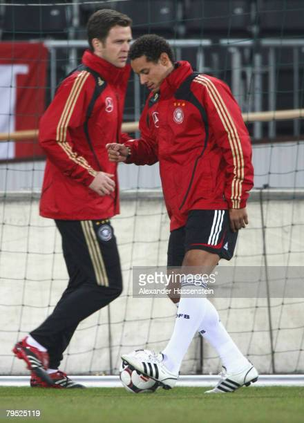 New player Jermaine Jones is seen in action with team manager Oliver Bierhoff during the training session of the German National football team at the...