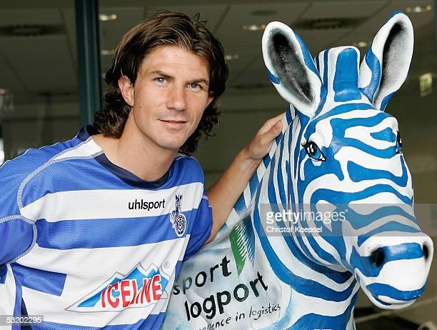 New player Kai Michalke stands beside the zebra during the team presentation of MSV Duisburg for the Bundesliga Season 2005 2006 on July 6 2005 in...