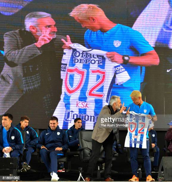New player Keisuke Honda of Pachuca is presented his shirt by Pachuca President Jesus Martinez during a press conference to unveil Pachuca's new...
