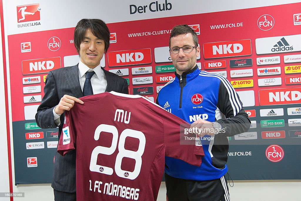 New Player Mu Kanazaki and head coach Michael Wiesinger of FC Nuernberg introduce Mu's new jersey during the press conference as he is presented as the newly signed player to 1. FC Nuernberg on January 30, 2013 at the Sportpark Valznerweiher in Nuremberg, Germany.